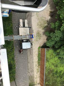 Kran zur Dachrinnenreinigung in München